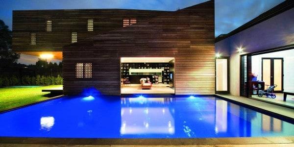 Trojan house timber exterior next to a pool